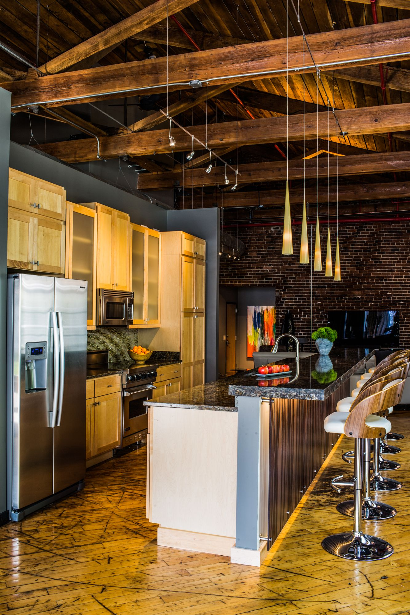 contemporary kitchen design with exposed beams and brick