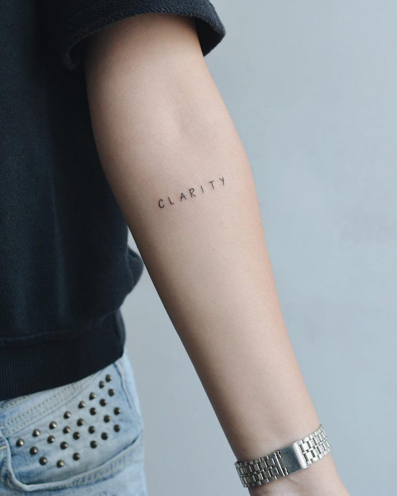 The Word Clarity Tattoo Inked On The Left Forearm