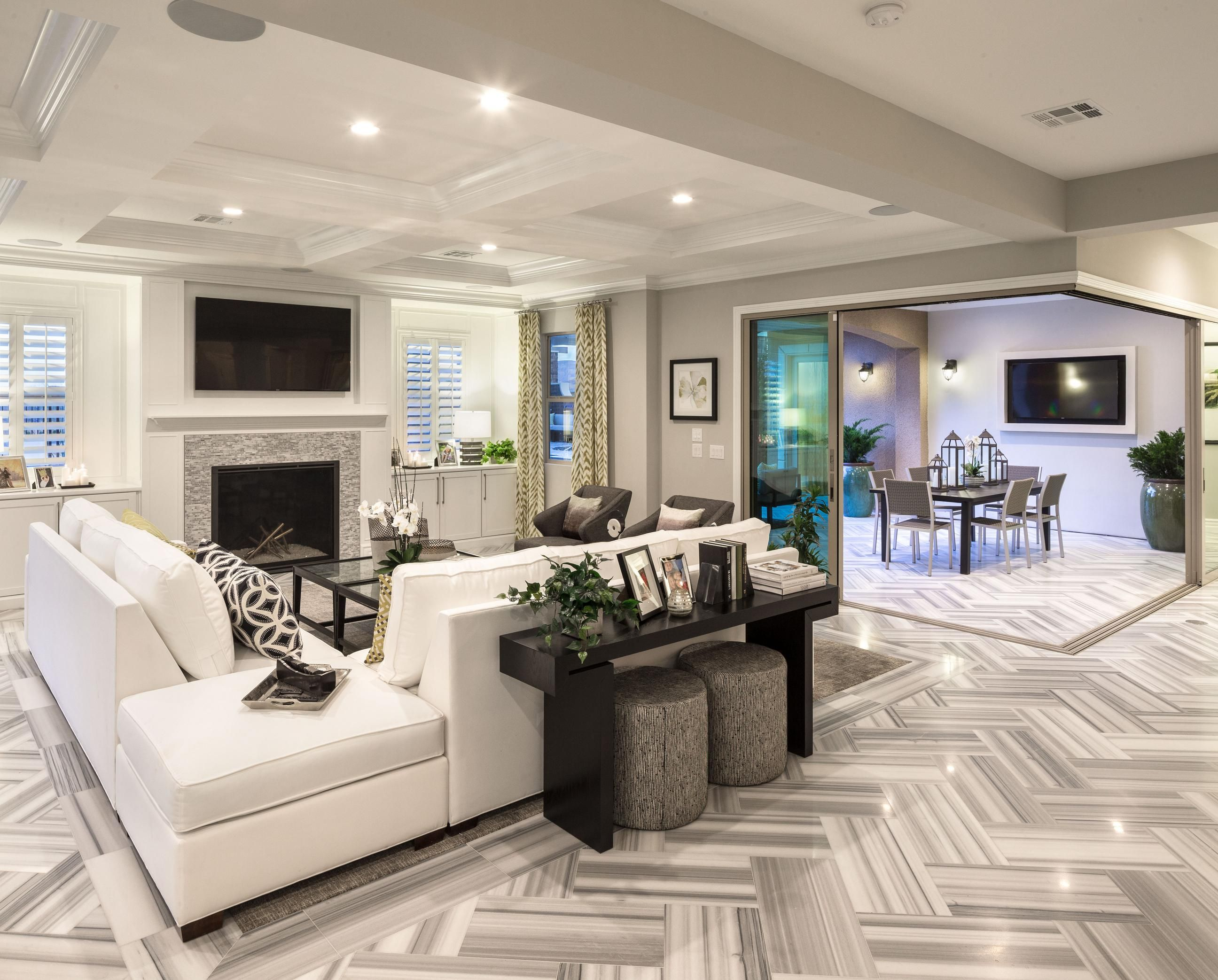 Enjoy this exquisitely spacious family room from the Los Altos Verano model  home in Las Veg… | Model home decorating, Mediterranean living rooms,  Family room design