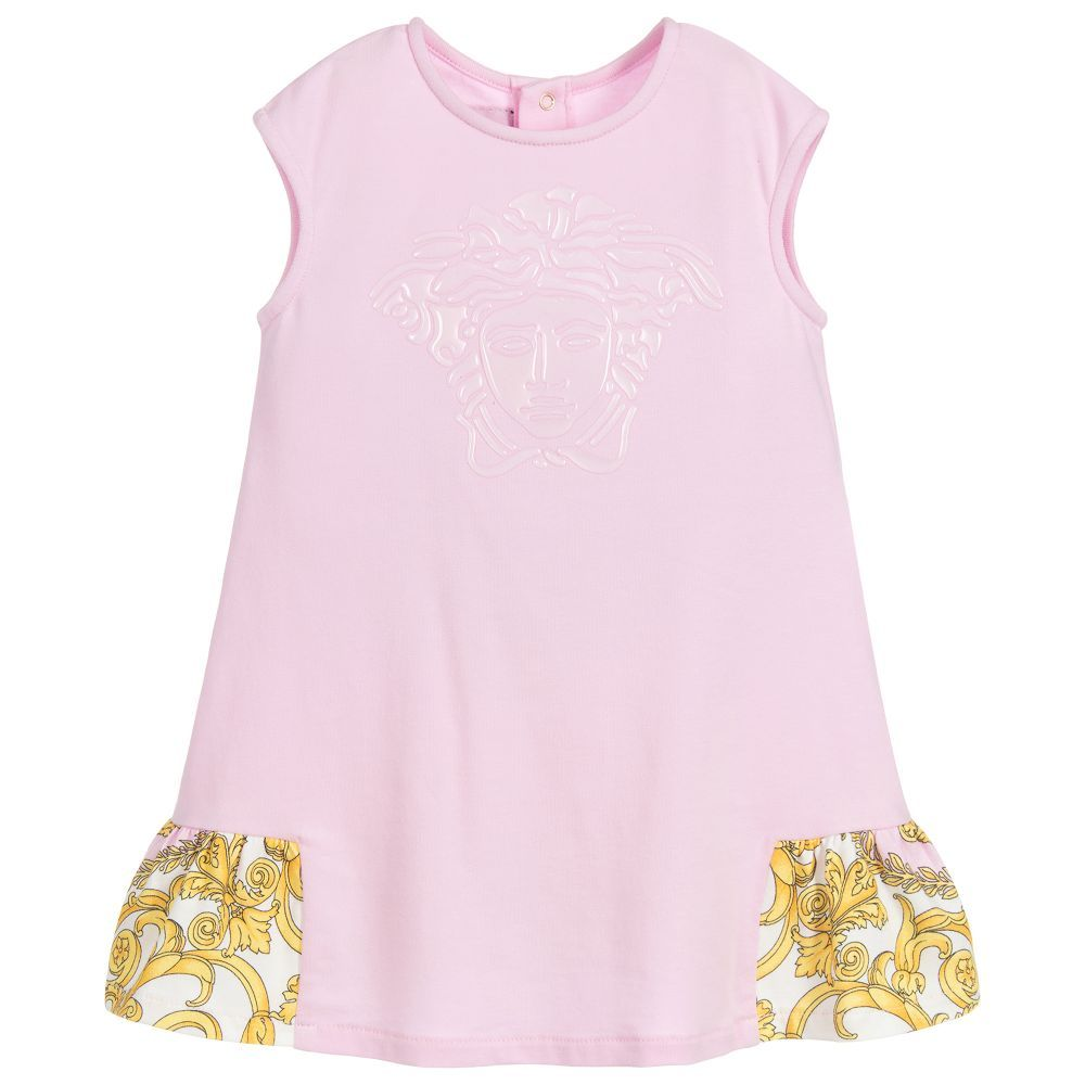 e19b05f1 Little girls pink dress by luxury brand Young Versace, with a gel-like  Medusa logo on the front. Made in soft and stretchy cotton jersey, the back  hem has a ...