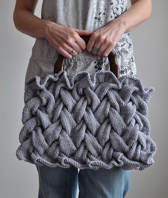 Plaited Fantasy - OOAK handknit designer handbag This unique bag is a fruit of a very long kniting session. Each and every stitch has been carefuly hand crafted one by one with great care for details. The plaited pattern gives this bag an original 3D texture. The bag has a very practical cotton lining with three pockets for your bits and pieces. The wooden handle is very comfortable and smoothly finished.