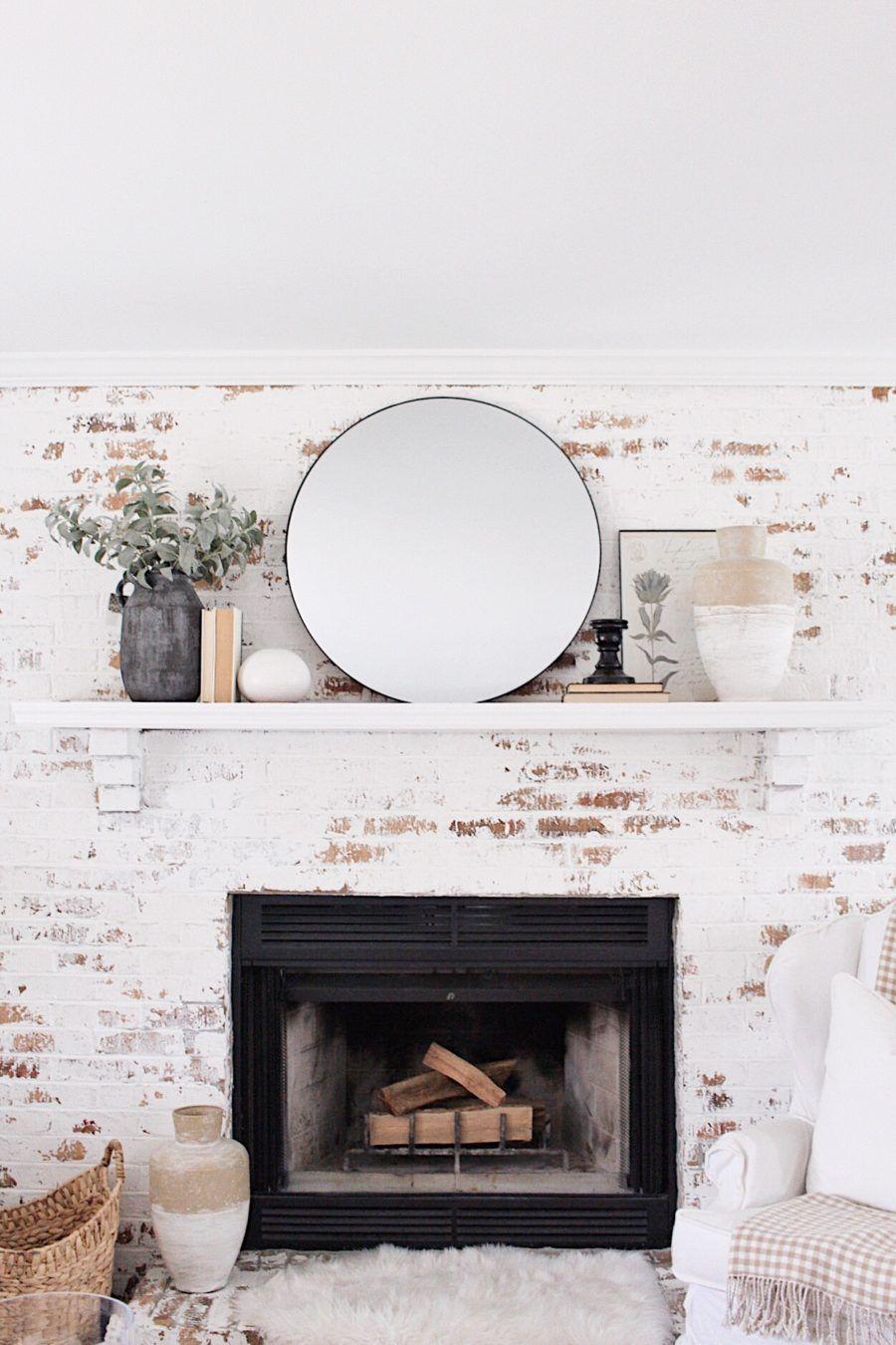 White Brick Fireplace Mantle Decor Ideas With Round Black Mirror
