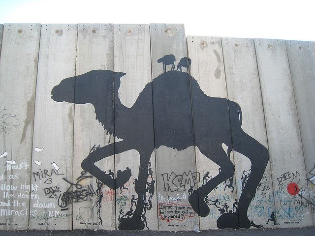 Artwork by SAM3 on and along the Israeli west bank barrier in Bethlehem-5 by yobosayo, via Flickr