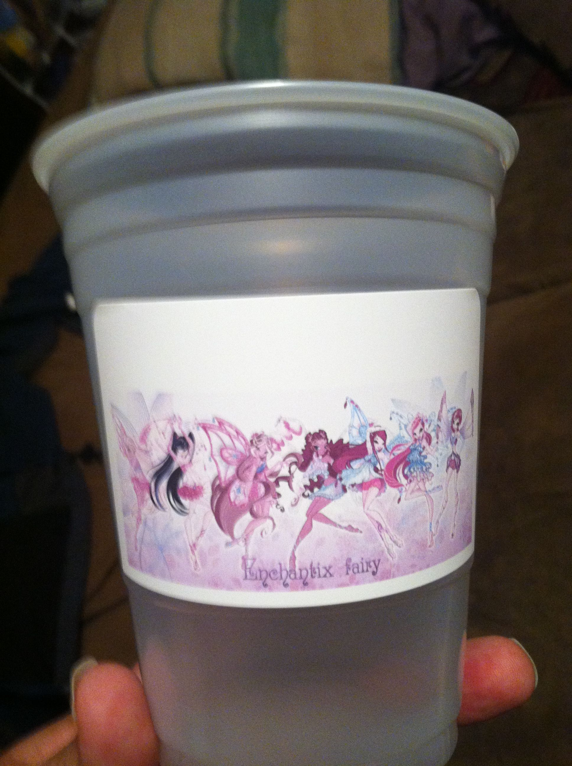 Winx Club party cups. We couldn't find any to purchase without spending a fortune. So, we bought printable name tags and clear cups and went to work.