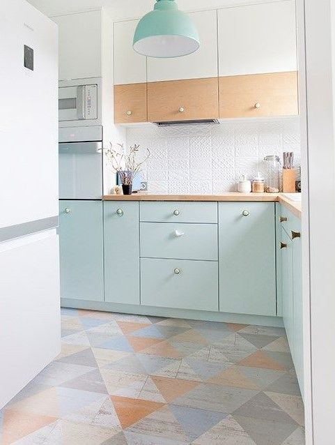 light and airy small kitchen with very light blue-green cabinets