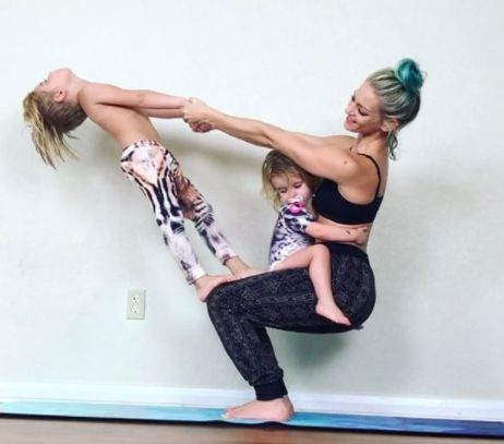 this mom and her kids doing yoga together will make your