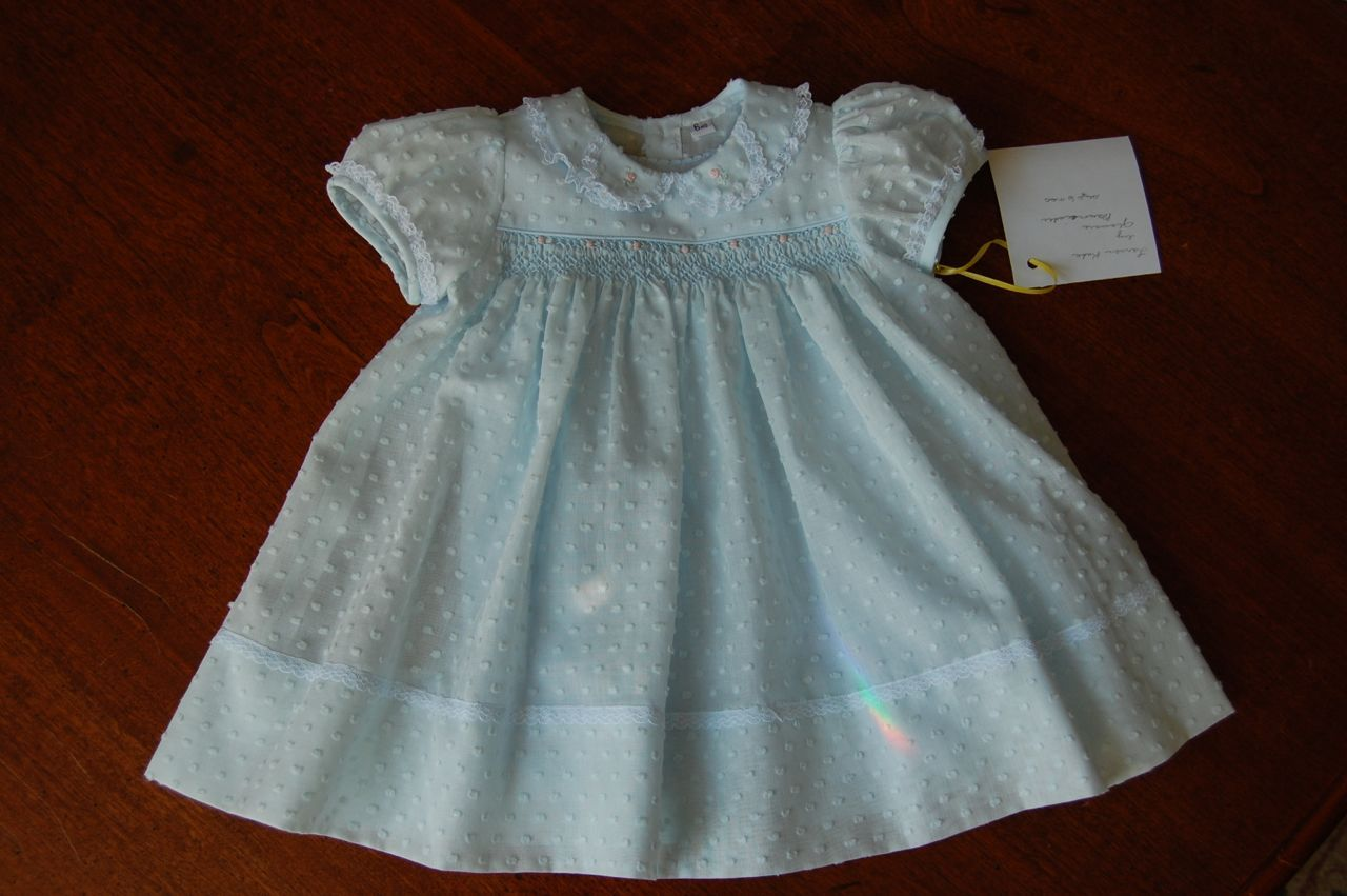 5aefeb5d3ba7f The Old Fashioned Baby Sewing Room: Emma's Smocked Baby Dress is Dotted  Swiss