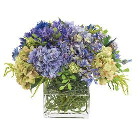 "Faux agapanthus and hydrangea arrangement. Made in the USA.   Product: Faux floral arrangementConstruction Material: Polyester and glassColor: Purple and blueFeatures:  Manufactured in the USAIncludes faux hydrangeas Dimensions: 15"" H x 20"" W Note: This product is supplied by Natural Decorations, Inc."