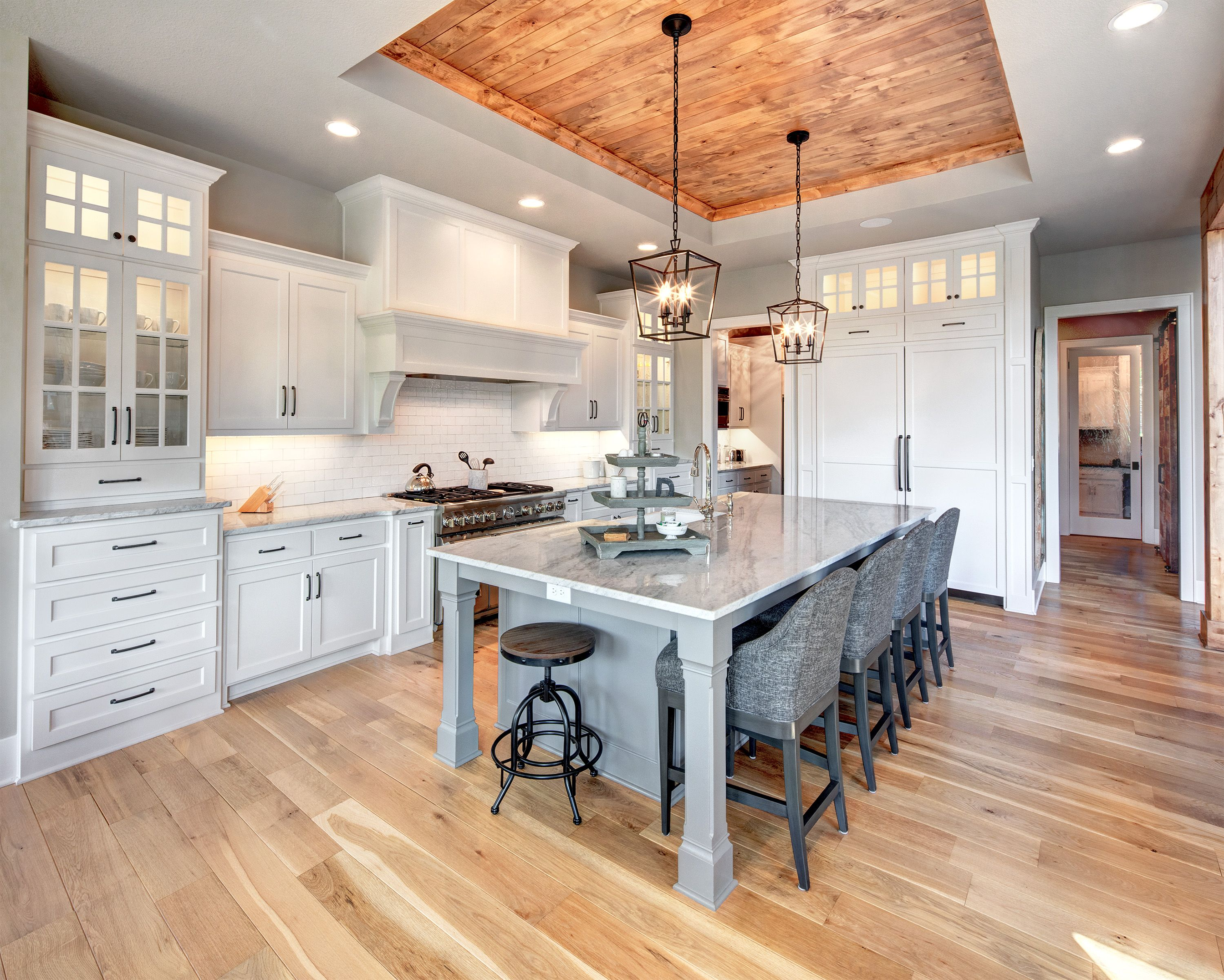Kitchen With Wood Tray Ceiling White Cabinets And Kitchen Island