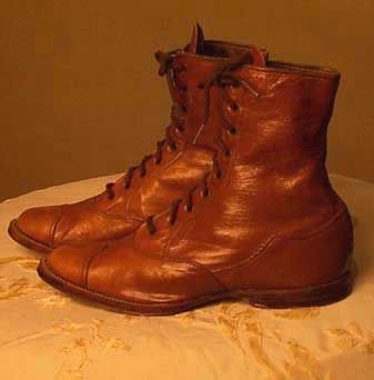 """Laced Boots, c1890; Fine grade leather (calfskin), brass nails, canvas lining. Label: Stamped on sole: 10 1/2 E; stamped in ink on lining: 10 1/2, 3895 and 02. Measurements: 8"""" L; 2 1/4"""" W; 5 5/8"""" H including 3/8"""" heel.  Comments: Leather has a marvelous patina and rich color on these museum quality children's boots. Workmanship and design are of the highest standard."""