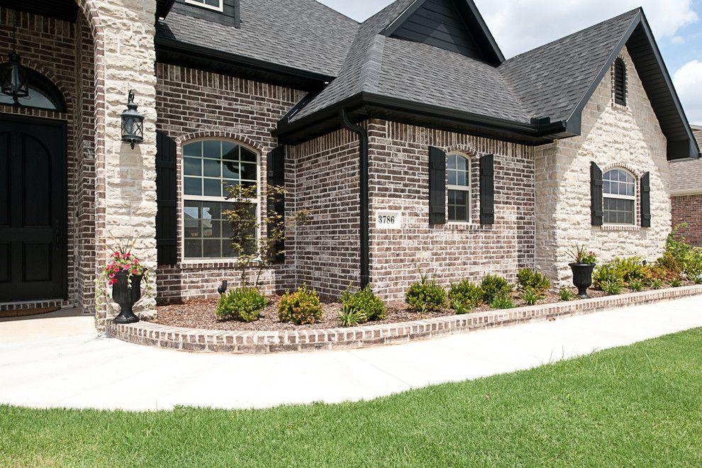 Light Brick With Dark Roof And Shutters Brick Exterior House Brick House Exterior Colors Exterior Brick