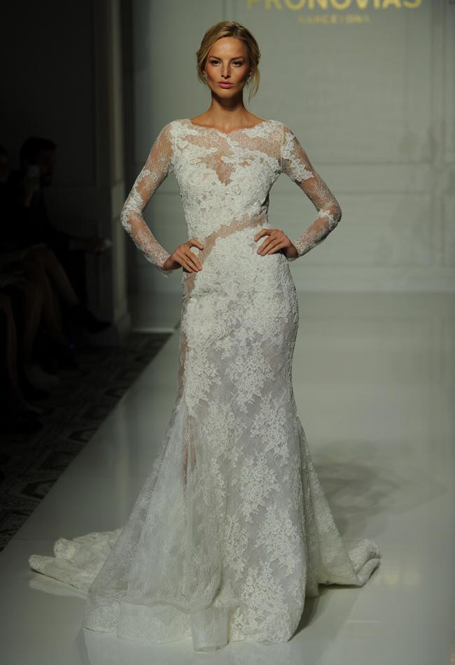 Pronovias Fitted Lace Wedding Dress With Cross Body Sheer Details And Long Illusion Sleeves