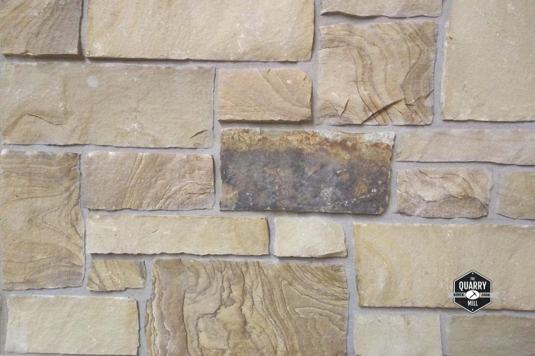 Brentwood natural stone veneer is known for its swirling wood-like grains. It is subject to heavy variation as it is natural stone; some pieces will have no visible grains, some will have linear veins, and some will have a swirling wood-like pattern. #thinstone #realstone #quarry #freeshipping #thinstoneveneer #thinveneer #masonry #stonesiding #naturalstoneveneer #realstoneveneer #quarrymill #buildingmaterials #architecture #stonedesign #designideas #designinspiration #homedesign #woodgrainstone