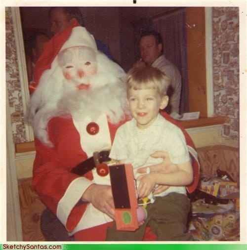 I'm pretty sure that is Jigsaw from the Saw movies in that Santa costume: