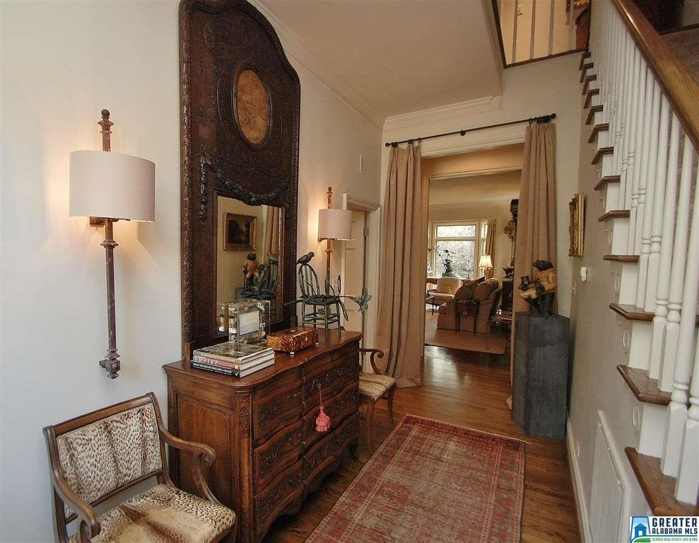 Traditional Hallway with Crown molding, Hardwood floors, Flat panel cabinets, Wall sconce, High ceiling