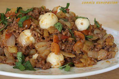 Ground Beef Potatoes Onions Garlic And Tomatoes Cooked A La Menudo And Garnished With Hard Boiled Quail Eggs Beef Recipes Ground Beef Recipes Boiled Chicken