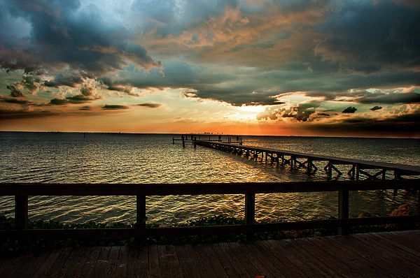 The Sun Sets Over Tampa Bay As You Look From Bahia Beach In Ruskin Pier Toward St Petersburg Florida On Hjorizon