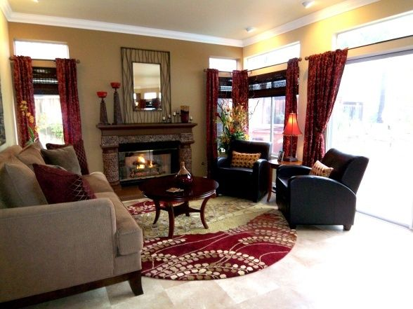 living room palette idea - Black furniture, maroon accent ...