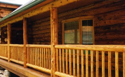 Lovitt 39 s natural gold oil based log home stain in honey for How to stain log cabin