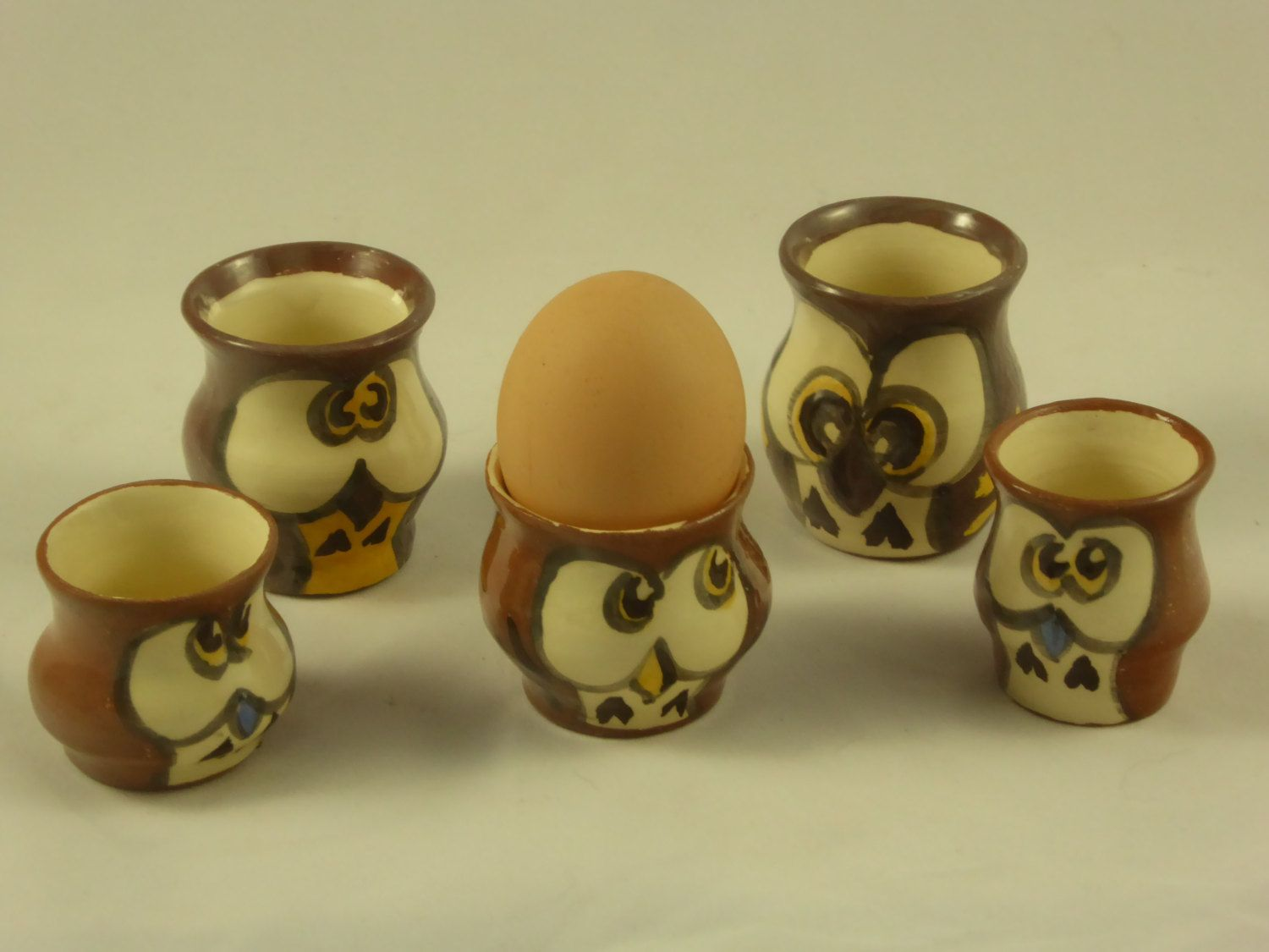 Five small owl-ornaments or eggcups by AlecPDavis on Etsy