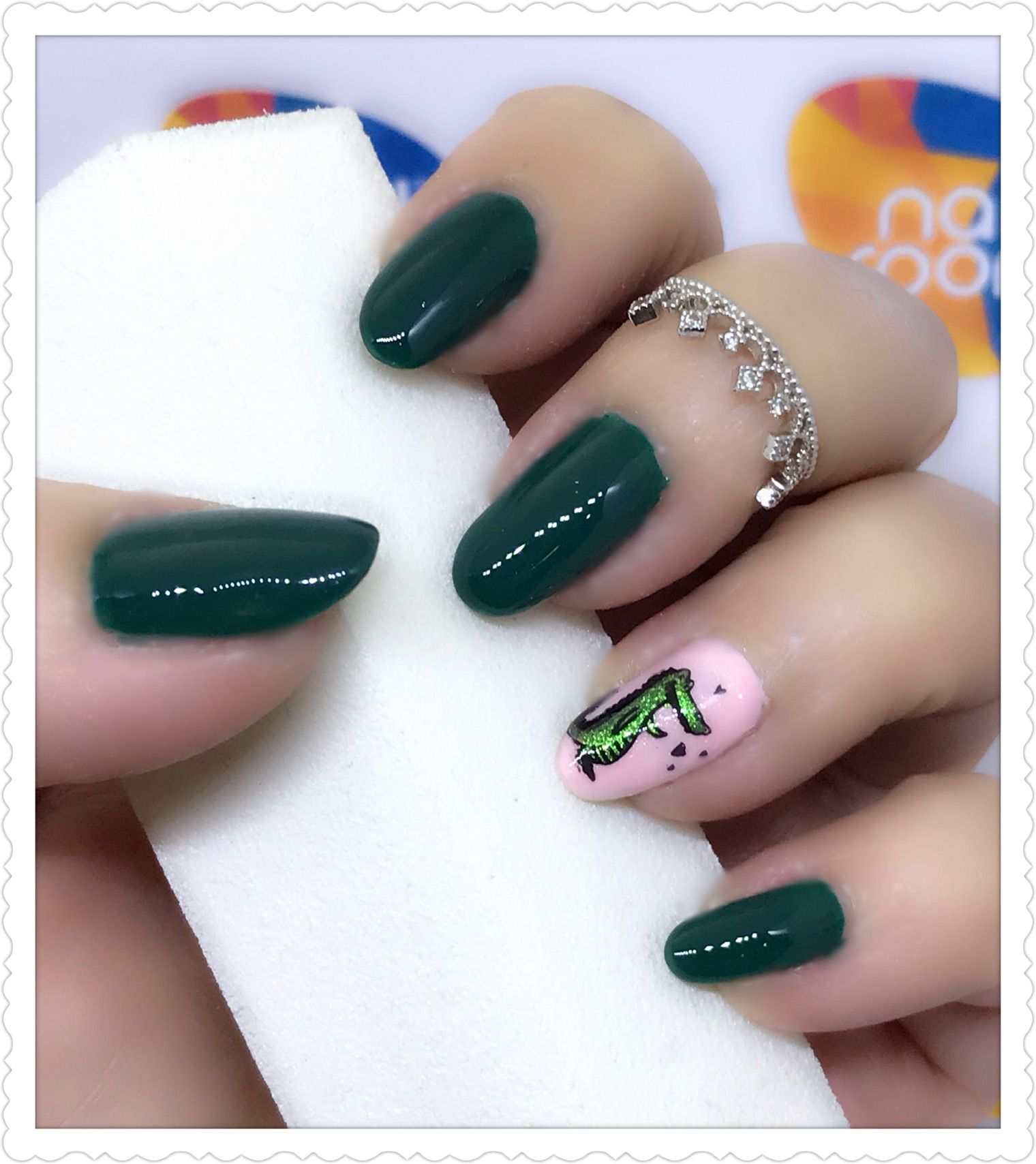 Dark green nails with alligator accent nailart using reversed ...