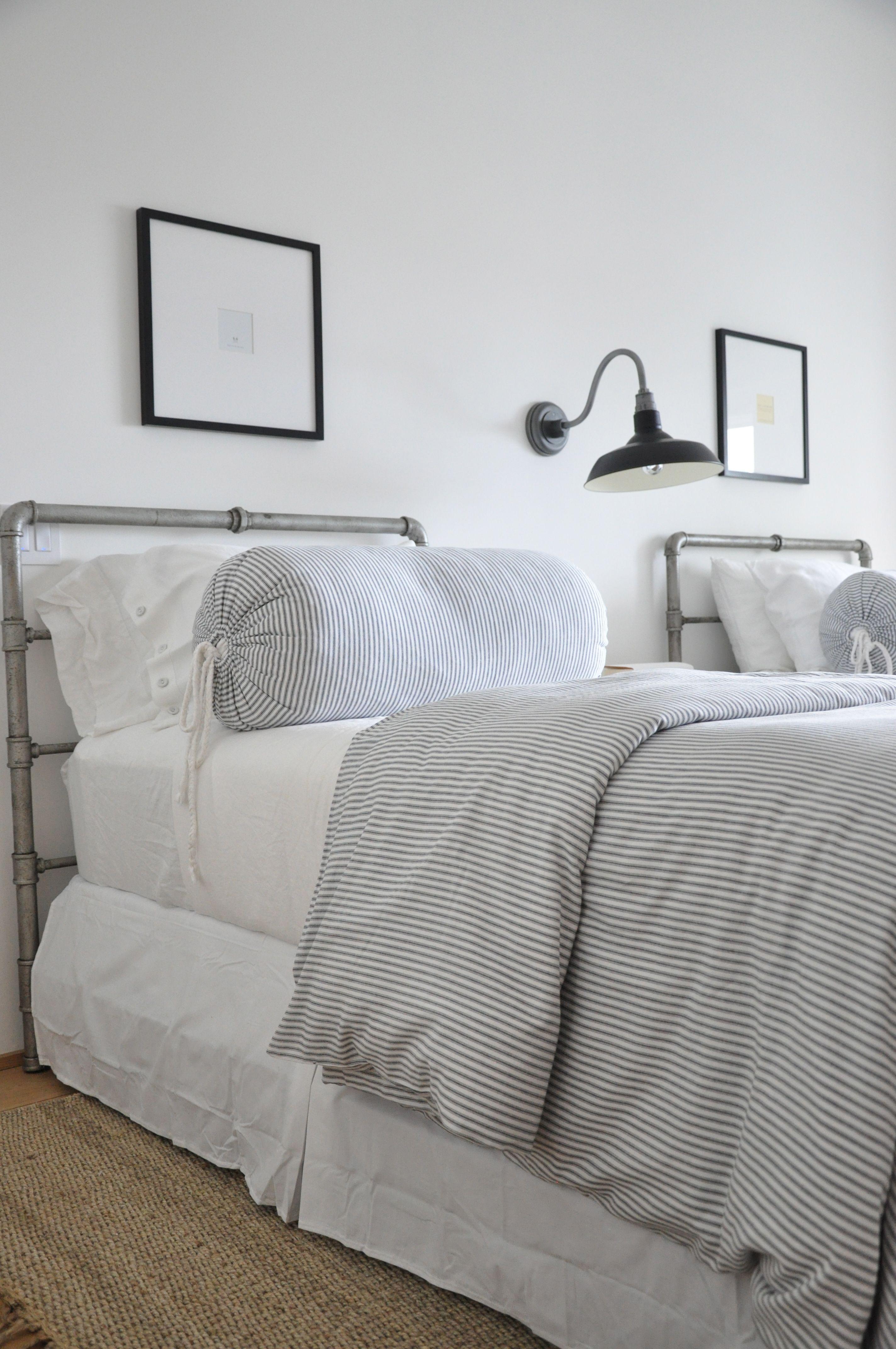 coastalinspired bedroom, twin beds, ticking stripe