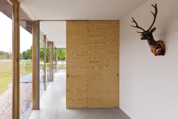 Underlayment doors at the entree home ideas plywood walls house