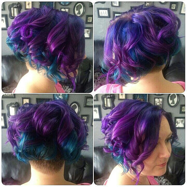 Violet and Blue Layered Color Melt  Violet and Blue Layered Color Melt : Kris's hair color in this photo was for training color melting techniques.  Pravana Vivids was used to make the custom blue and purple tones.  I left the undercut of her hair natural | by HAIR RAIZERS SALON