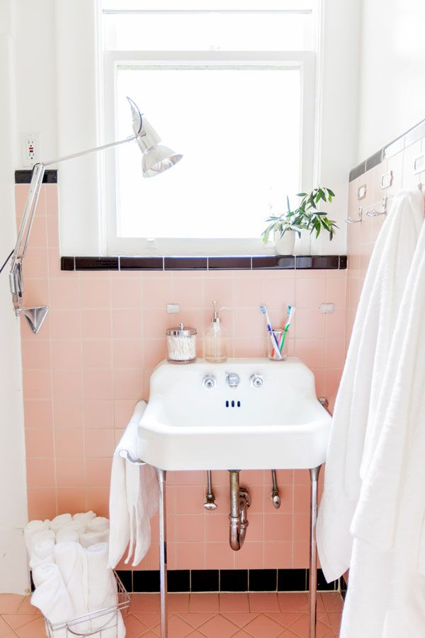 check out this vintage bathroom the pink tiles wall mounted sink chrome lamp are so classic and no bathroom is complete without fluffy white towels - Pink And Black Bathroom Accessories