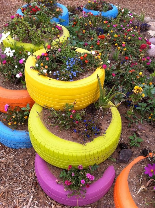 colourful tires for a cute childrens garden this will make gardening fun and will give your garden a memorable talking point