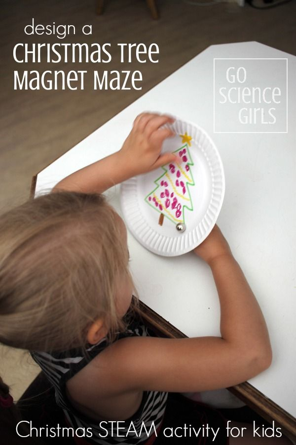 Design a Christmas tree magnet maze game - Christmas STEAM activity for kids to learn about physics through play. It also works on kids sense of proprioception (one of the seven senses).