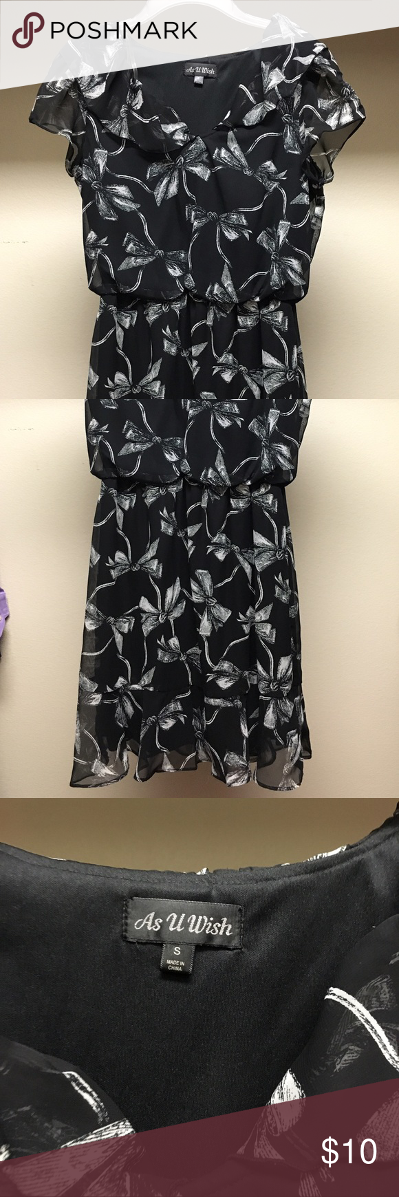 Like New Bow tie Dress small Like New Black Bow tie Dress size small. Super comfy and very flattering! Dresses Midi