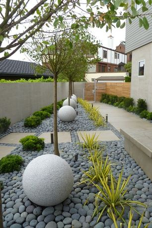 Contemporary landscape yard with 0 4 cu ft mexican beach for Pebble garden designs