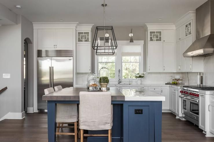 A Blue Kitchen Island Donning Both A Thick Marble And Walnut