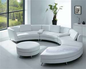A Round White Sofa Open At Side Stue Ved Kose