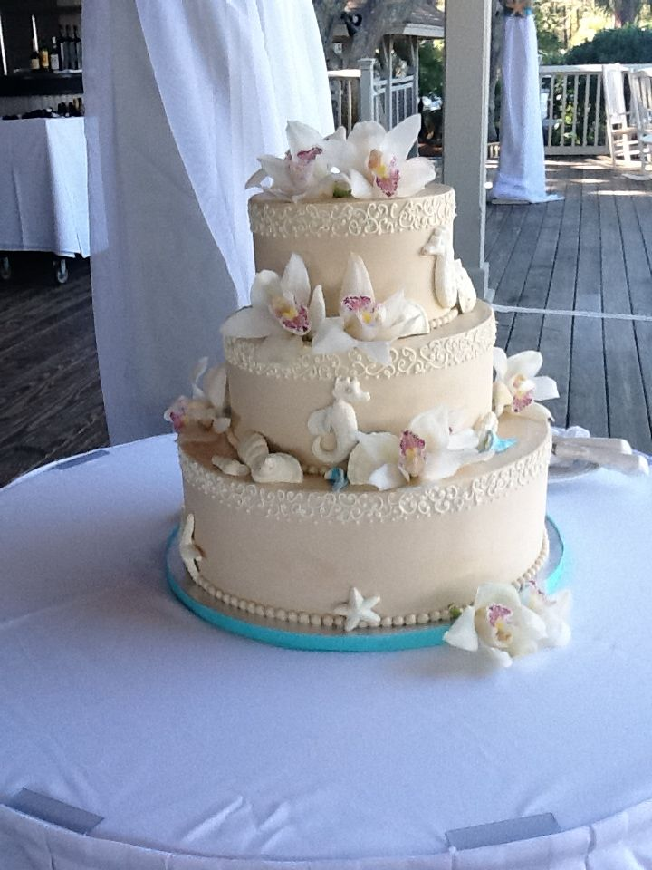 An Orchid And Beach Themed Wedding Cake Hiltonheadisland Lowcountryweddings Beach Theme Wedding Cakes Seashell Wedding Cake Seashell Cake