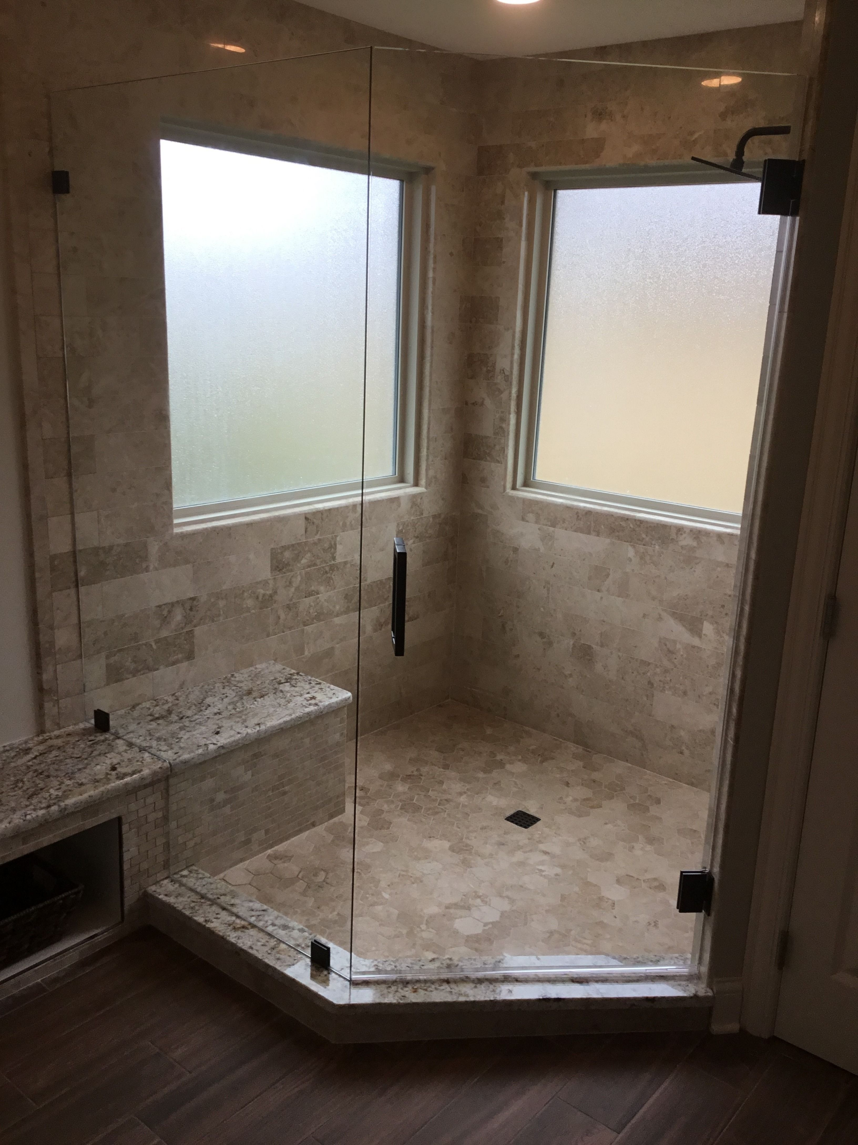 A Stunning Neo Angle Shower Enclosure With Panel Clamps And