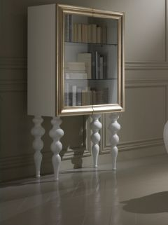 Diva Collection white lacquered display cabinet. Shown here with gold leaf surround.