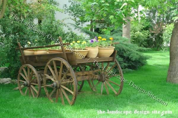 Rustic horse drawn wagon used as garden decor and decoration.