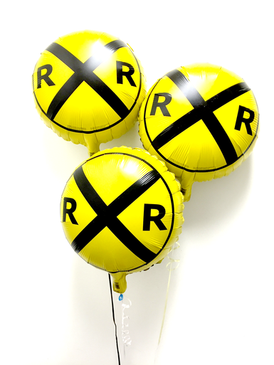 """Yellow railroad crossing mylar (foil) balloon pack. This train balloon has a imprint of the popular """"RR"""" crossing road sign. Excellent room decor item for your little engineer's a train theme birthday party. You can place these balloons at the event/party entrance or use them as a centerpiece on your table with a balloon weight. Each package contains total 3 train balloons, measuring 18 inches in diameter when inflated. Balloons ship flat."""