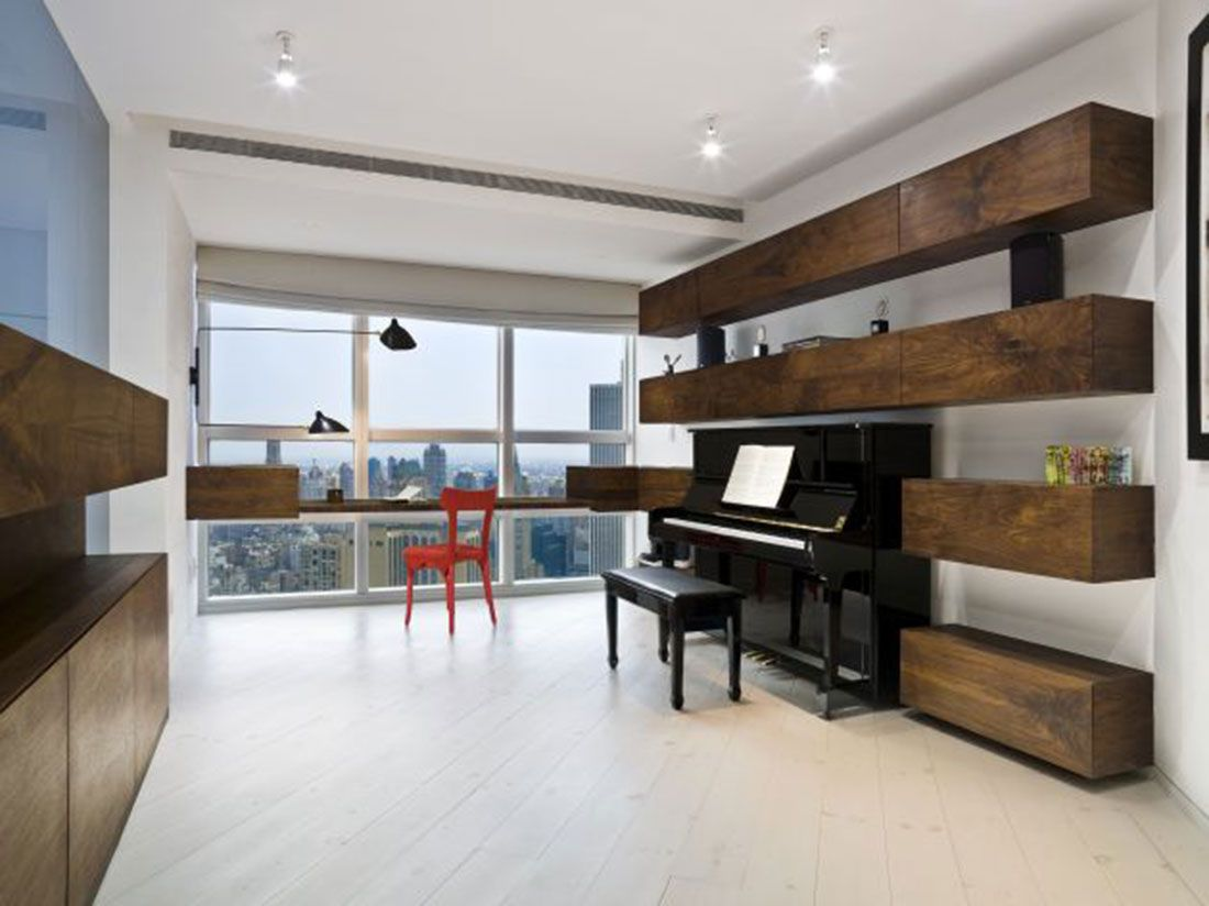 New York City Living Room Using A Piano As The Focal Point White Hardwood Flooring