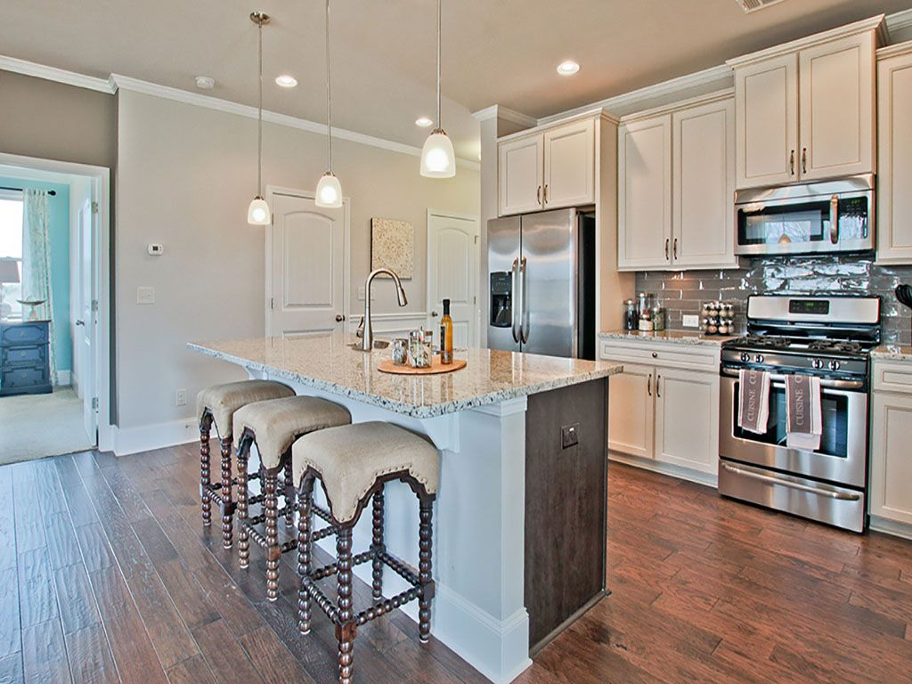 D R Horton At Sterling On The Lake Light Open Concept Kitchen With Granite Countertops And Stainles Replacing Kitchen Countertops Kitchen Models Countertops