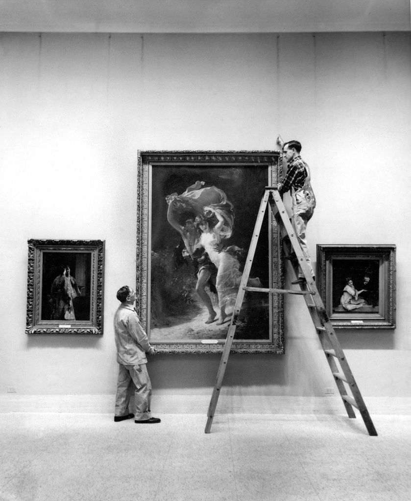 """Jan. 5, 1954: Pierre Auguste Cot's """"The Storm"""" was hung at the Metropolitan Museum, one of several hundred works that went on display in newly renovated galleries that grouped paintings by time period rather than nationality — an arrangement that the museum director Francis Henry Taylor hoped would """"bring order out of chaos."""" Photo: Eddie Hausner/The New York Times"""