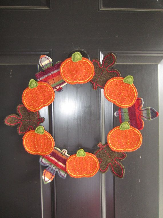 Upcycled Felted Wool Harvest Autumn Fall Pumpking and Leaf Wreath. $41.00, via Etsy.