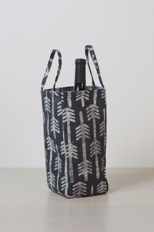 ABAN recycles plastic water bags that pollute cities and streets and pairs them with hand stamped and dyed fabrics created by Batik artisans in Ghana like this Rakia Wine Bag | Enrou