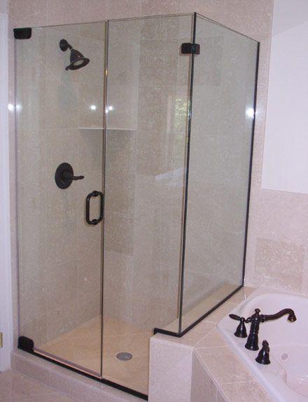Photo of Shower doors & bronze fittings – bathroom idea