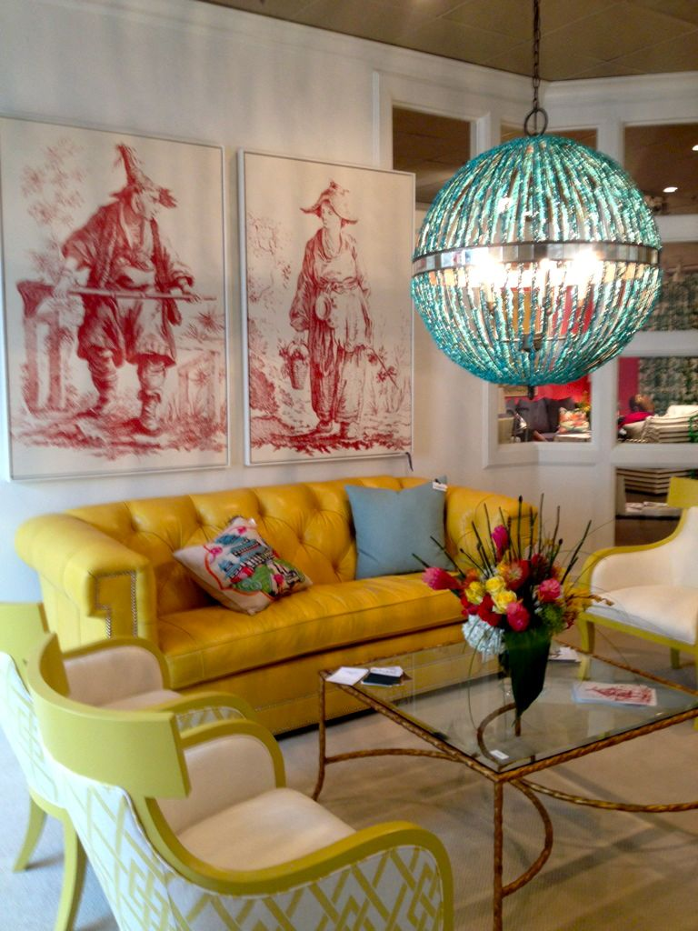 Love the two Chinoiserie prints and throw pillow, the contrast of red, yellow and blue.  Great vignette.  At High Point.