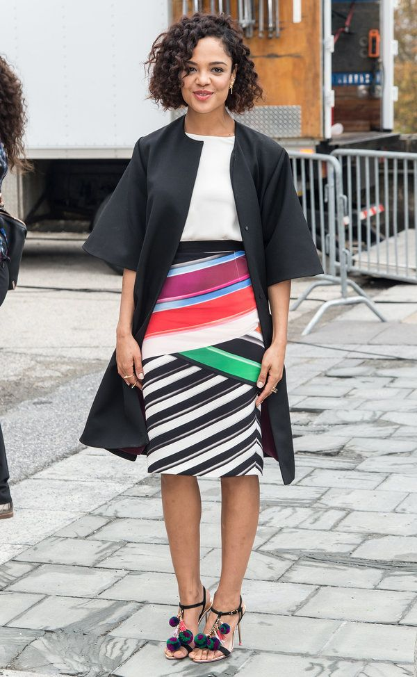 5a747067 Tessa Thompson pairs her printed skirt and cool shoes with a simple white  tee and a black coat