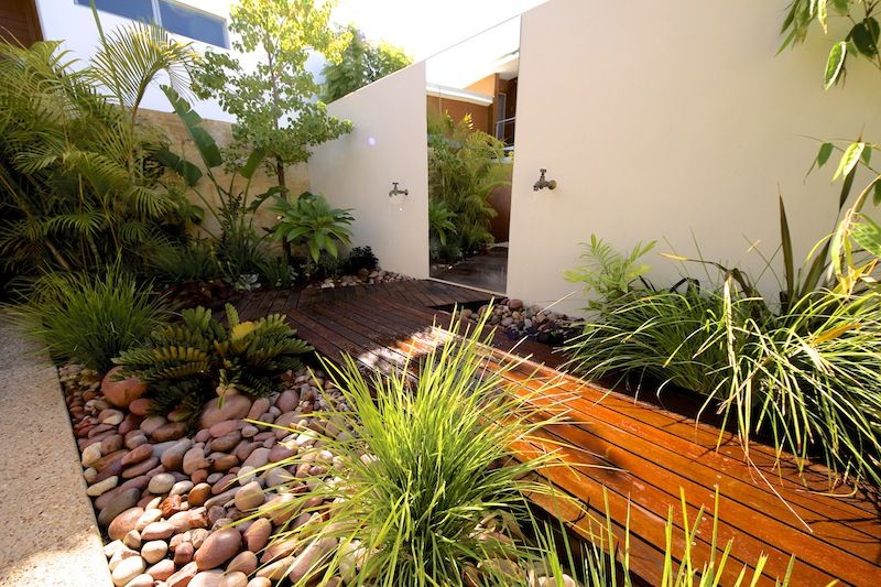 Small space landscaping - deck path - rock garden