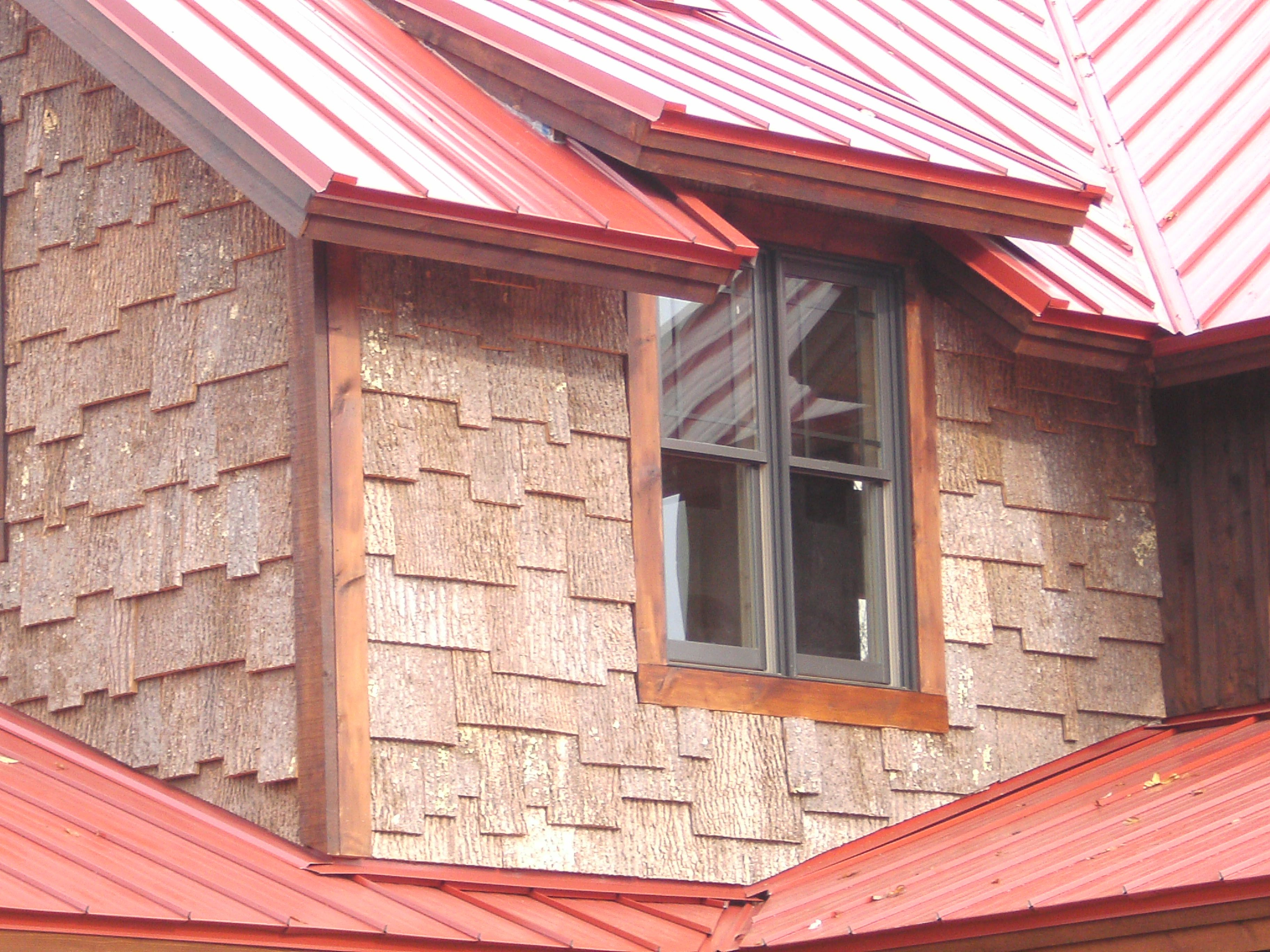 Popular bark in gable, also showing standing seam metal